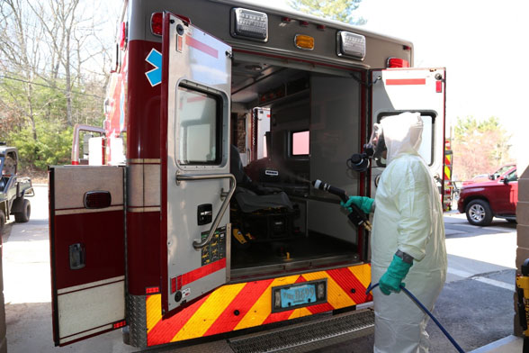 employee cleaning out an emergency vehicle